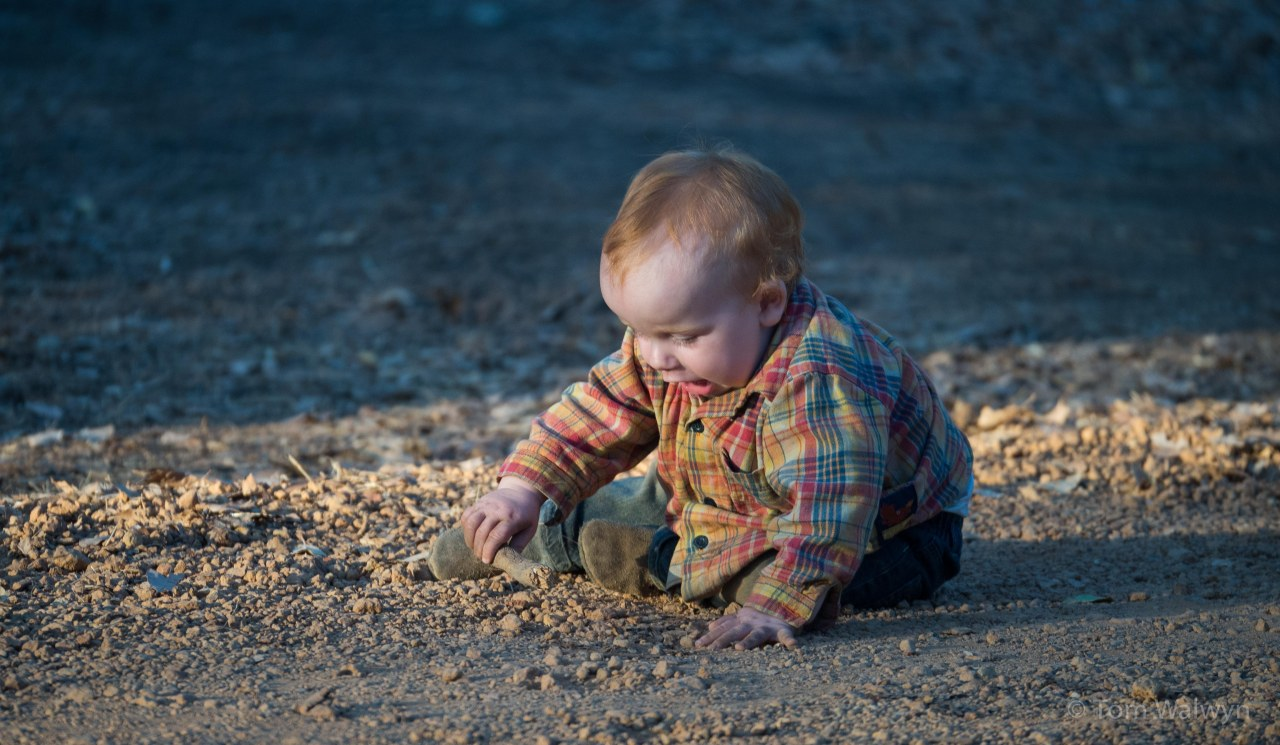Camping brings lots of time to sit and play with sticks and stones